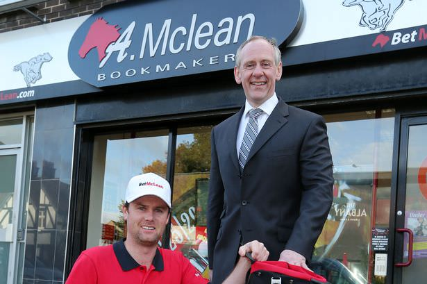 Jonny Caldwell with his new bag sponsor. Picture via Irish Mirror.