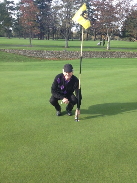 James Donovan picks the ball out of the hole after his second ace of the day, this one on the 19th, at  Grange Golf Club