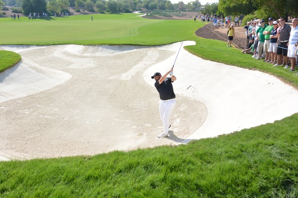 Shane Lowry tangles with a fairway bunker. Picture Fran Caffrey, www.golffile.ie