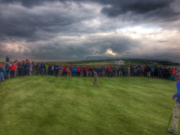 "Jack Hume wins this year's West of Ireland Amateur Open on the 18th green at Rosses Point. In the background, the "" old coast guard hut"" where the new third green has been created."