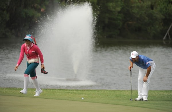 Pádraig Harrington looks at his line in Indonesia. Picture courtesy AsianTour.com