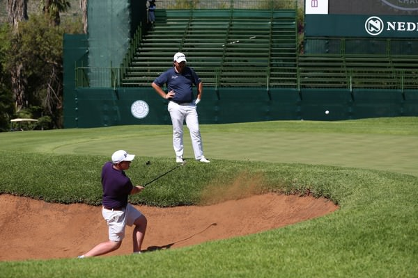 Shane Lowry watches his brother Alan play a bunker shot in practice at the Gary Player Country Club in Sun City. Picture David Lloyd / www.golffile.ie