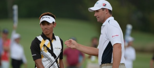 Winner Pádraig Harrington commiserates with runner up   Thanyakon Khrongpha. Picture:   Khalid Redza /   ASIAN TOUR