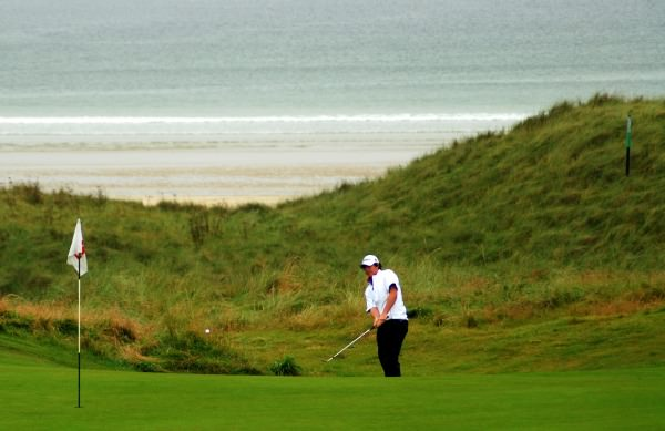A young Rory McIlroy chipping at Rosapenna