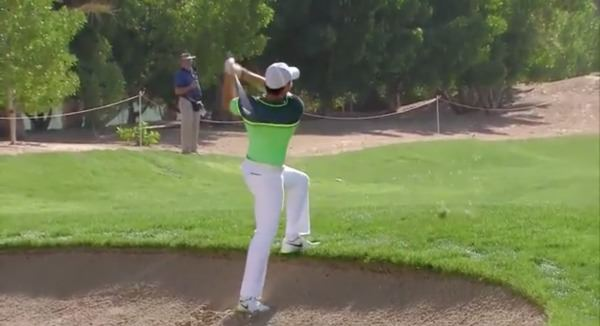 Rory McIlroy got up and down for birdie from an awkward lie on the third, above, to kickstart his round in Abu Dhabi.