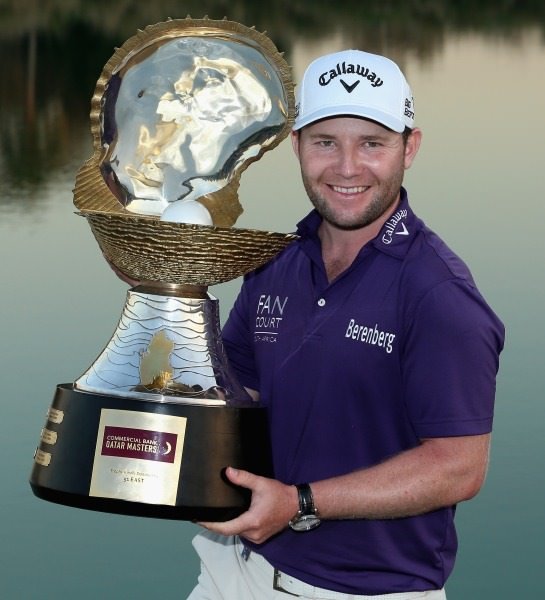 Branden Grace with the Commercial Bank Qatar masters trophy. Picture © Getty Images