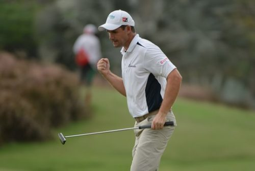 LIKE OLD TIMES. PÁDRAIG HARRINGTON CELEBRATES in indonesia PICTURE: KHALID REDZA /  ASIAN TOUR