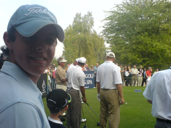 Rory McIlroy watches Darren Clarke, Thomas Bjorn, Tiger Woods and Ernie Els play an exhibition at the Emirates before the 2006 Dubai Desert Classic. Picture © Brian Keogh