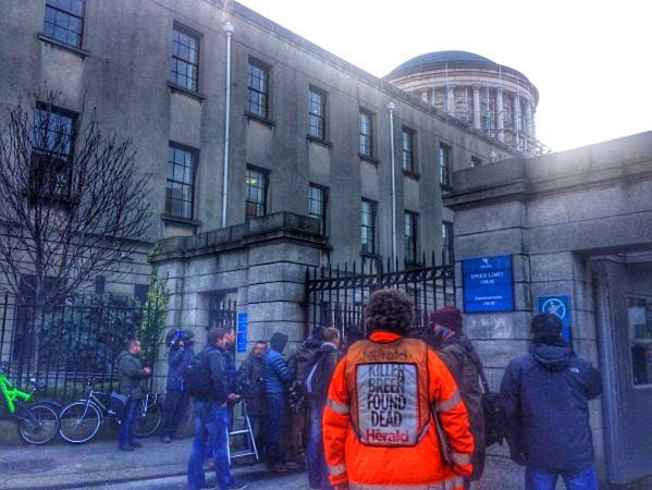 Photographers and onlookers wait for a glimpse of Rory McIlroy outside the Four Courts last Tuesday afternoon. He would not appear until the building closed after 9pm but only to head to another office nearby for late night talks with his legal counsel.