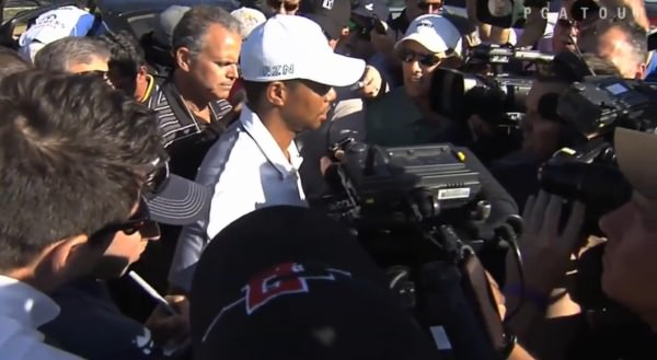 Tiger Woods talks to the press following his latest withdrawal