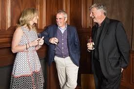 Paul McGinley and Fr Brendan McBride (right) chat to Celine Kennelly at a function