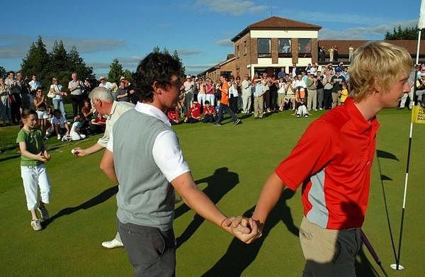 Rory McIlroy commiserates with Simon Ward after winning the 2006 Mullingar Scratch Cup in a playoff.
