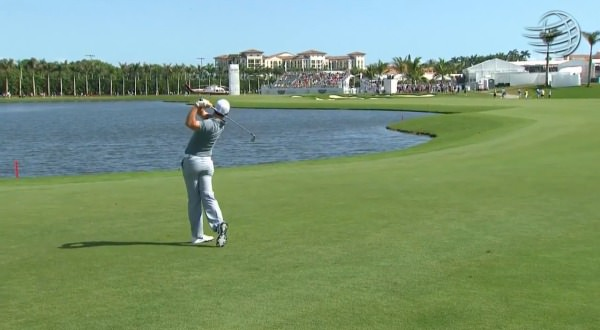 Rory goes for a cut with three-iron for his second shot to the par-five eighth.