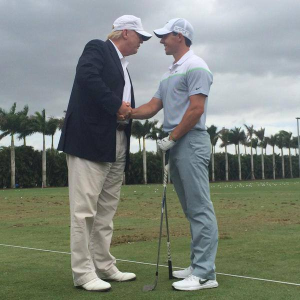 Donald Trump returns Rory McIlroy's three-iron at Doral last week. Picture via Twitter/@CDW_Jessica