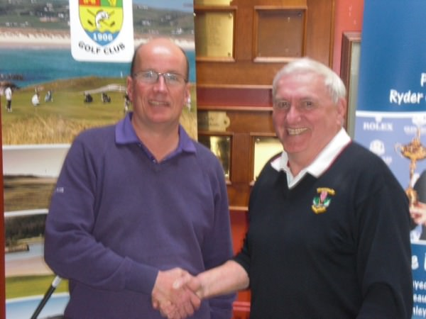 Mr. Barry Ramsay, honorary secretary North Western Golfing Alliance, congratulating Alliance Captain Brian Wallace on his year in service
