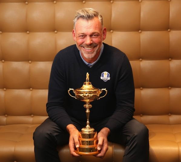 Aside from a range of television and broadcast interviews in a hotel opposite Heathrow's Terminal Five, Clarke took time out to pose for his first official pictures with the newly reconstituted Ryder Cup Trophy, which has had an additional golden band added just above its base since Europe's triumph at Gleneagles last September, to accommodate the results of the matches going forward.