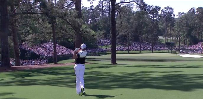 Rory McIlroy draws one around the trees at the 15th to set up a birdie in round three of the Masters
