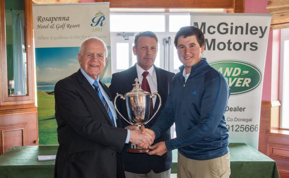 Colm Campbell is presented with the Rosapenna Senior Scratch Cup by sponsor Noel McGinley of McGinley Motors (Letterkenny) and Brian Kelly, captain of Rosapenna GC.