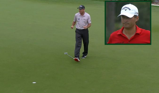 Jim Furyk celebrates as Kevin Kisner looks on helplessly