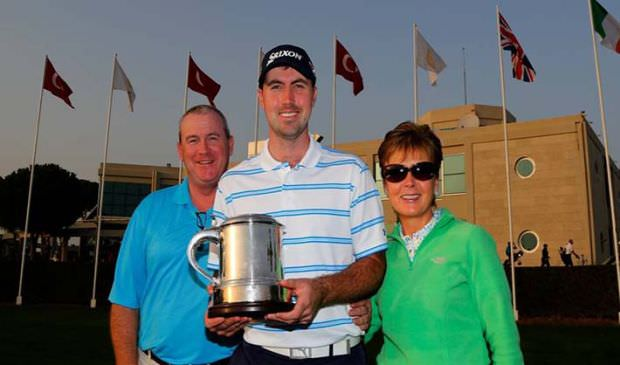 Niall Kearney, pictured with his parents in Turkey following his win in the Titleist PGA Playoffs last year.