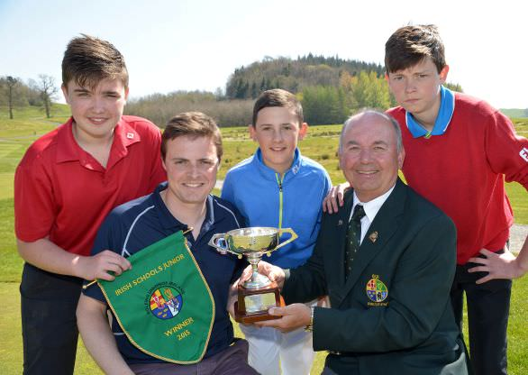 Michael Connaughton (President, Golfing Union of Ireland) presenting Michael Bell (Team Manager, Ballyclare High School) with the 2015 Irish Schools Junior Championship Trophy after their victory at Farnham Estate Golf Club, Cavan. Team members (from left) Stephen McCalmont, Christopher Nesbitt and William Beatty. Picture by Pat Cashman