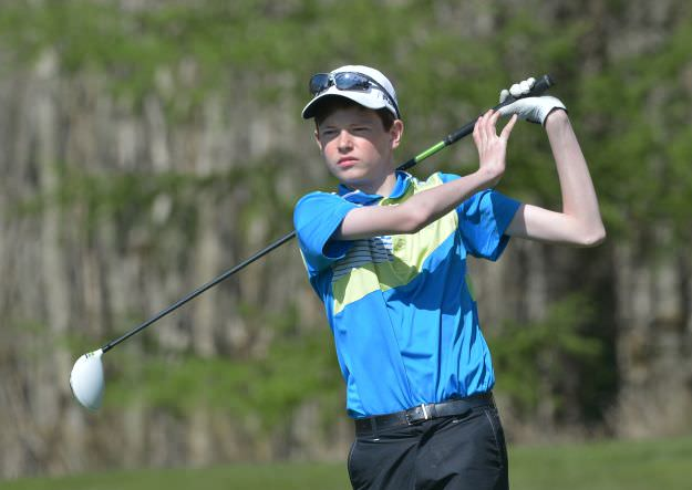 William Beatty (Ballyclare High School) driving at the 15th tee in the final 2015 Irish Schools Junior Championship. Picture by Pat Cashman