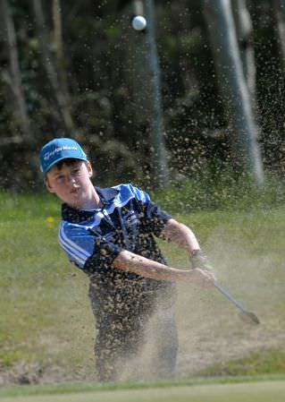 Tommy Maher (CBS Mitchelstown) playing from the bunker at the 14th green in the final 2015 Irish Schools Junior Championship. (22/04/2015). Picture by Pat Cashman