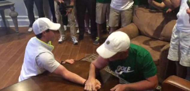 Down and out. Rory McIlroy loses to 17-year old  Brad Dalke  in arm wrestling. Still has the edge in golf mind you.