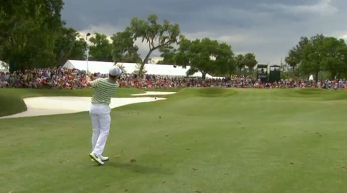 Rory McIlroy hits hit third close at the ninth