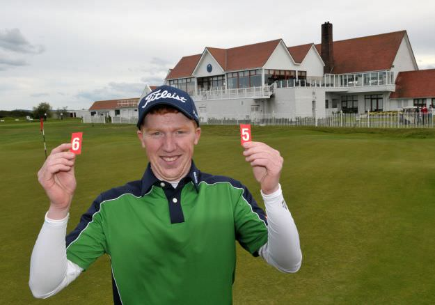 Gavin Moynihan (The Island) after shooting a course record 65 in the third round of the 2015 Irish Amateur Open Championship pctured on the 18th green at The Royal Dublin Golf Club today (09/05/2015). Picture by  Pat Cashman