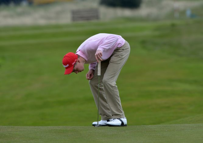 Kevin LeBlanc (The Island) looking at the line of his putt on the 4th green in the third round of the 2015 Irish Amateur Open Championship at The Royal Dublin Golf Club. Picture by  Pat Cashman