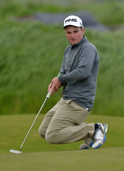 Jack Hume (Naas) watching his birdie putt on the 3rd green in the third round. P icture by   Pat Cashman