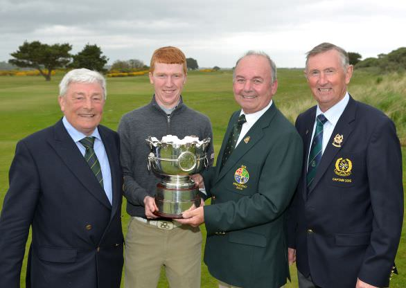 Michael Connaughton (President, Golfing Union of Ireland) presenting Gavin Moynihan (The Island) with the Irish Amateur Open Championship trophy after his victory. Also in the picture are Enda McDermott (2014 Captain, The Royal Dublin Golf Club) and Eugene Reilly (Captain, Island Golf Club). Picture by Pat Cashman