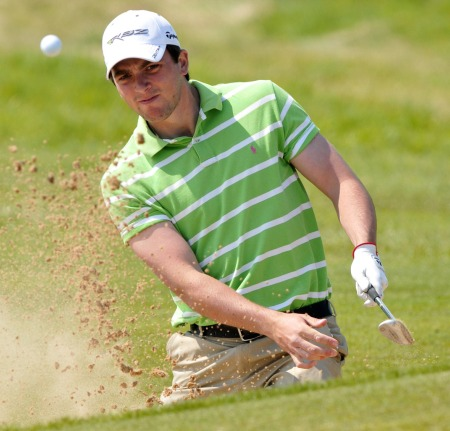 Reeve Whitson splashes out of a bunker in the 2012 Interpros at Royal County Down. Picture by Pat Cashman