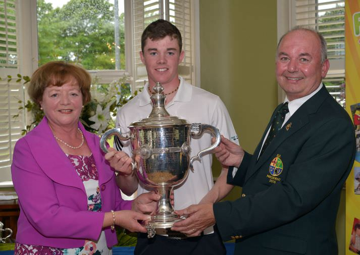 Michael Connaughton (President, Golfing Union of Ireland) presenting Stuart Grehan (Tullamore) with the CityNorth Hotel sponsored East of Ireland Championship trophy at County Louth Golf Club (01/06/2015). Also in the picture is Mrs Sinead Kennedy (wife of the club Captain). Picture by  Pat Cashman