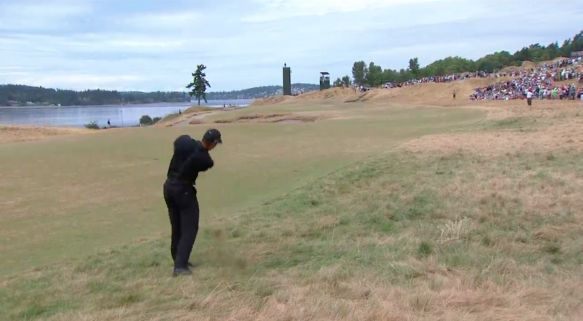 Tiger Woods in a familiar place on Thursday at Chambers Bay, the rough
