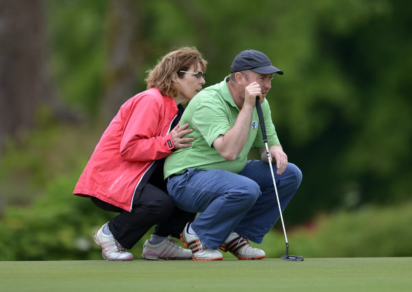 Behind every good man... Joe Lyons (Galway) with his wife Vera lining up his putt on the 18th green during the first day of the 2015 Irish Mid Amateur Open Championship at New Forest Golf Club today (20/06/2015) . Picture by Pat Cashman