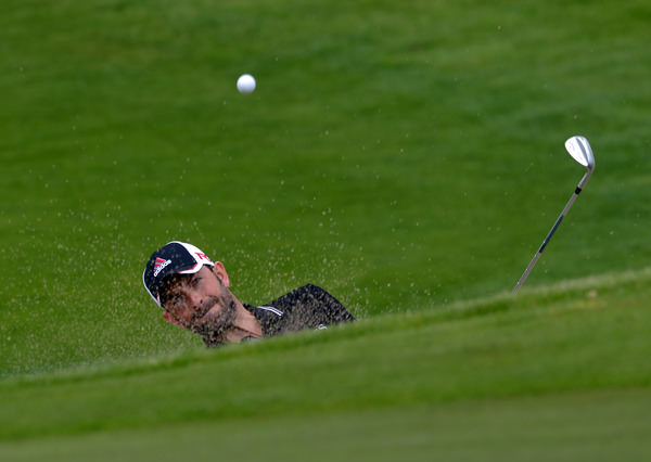 Dave O'Donovan (Muskerry) blasting from the bunker at the 18th. Picture by Pat Cashman