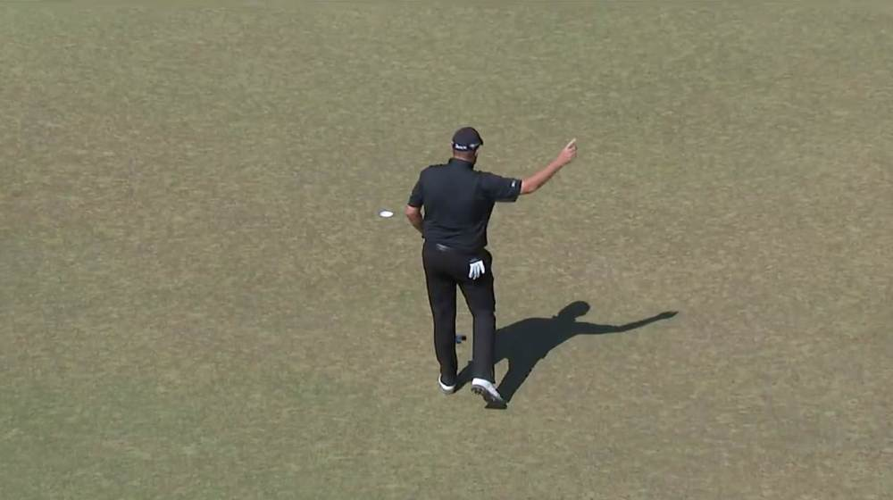 Shane Lowry salutes the crowd after a birdie