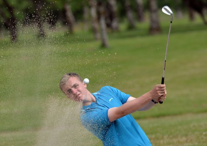 Thomas Mulligan (Co Louth) coming from the bunker at the 16th during the second round of the 2015 Irish Boys Amateur Open Championship. Picture by  Pat Cashman