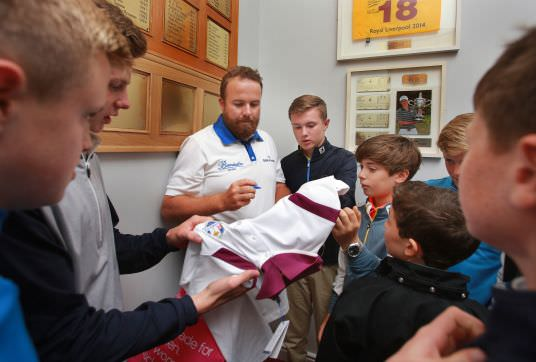 Shane Lowry signs an autograph on some of his new Shane Lowry for Kartel apparel for some of the boys at the Under 13 Series event at Greystones on Monday. The clothing is available from Heatons. Picture: Ronan Lang