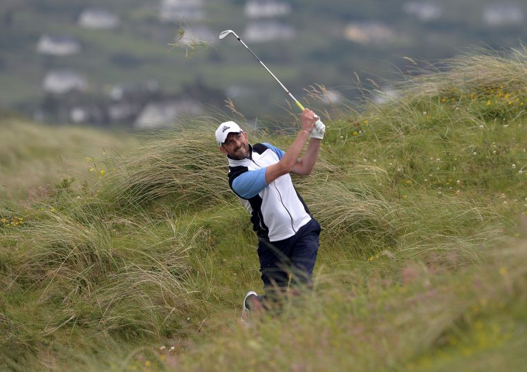 Dave O'Donovan (Munster) playing from the rough at the 14th hole during the second day of the 2015 Interprovincial Championship at Rosapenna Golf Club. Picture by  Pat Cashman