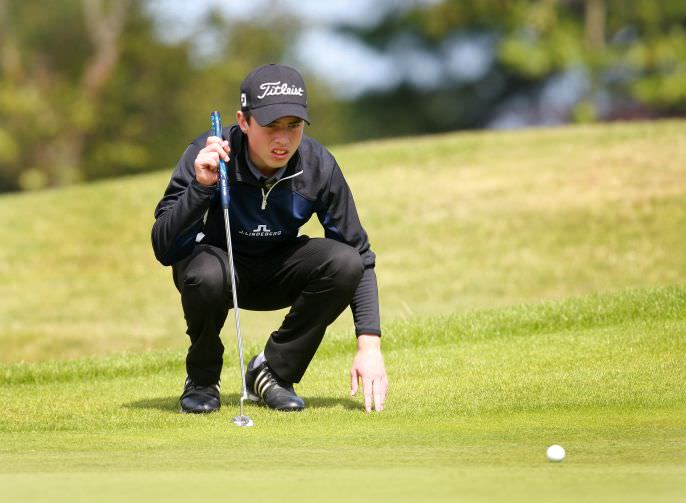 Odhrán Maguire lines up a putt. Picture: Ronan Temple Lang