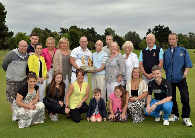 Michael and Stephen Finlan (Dunmurry Springs / Grange Castle) with the 2015 CPL Resources sponsored Father & Son trophy after their victory at the Castle Golf Club (12/07/2015). Also in the picture are extended family members. Picture by  Pat Cashman