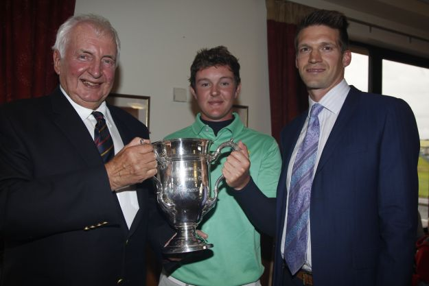 Peter Sinclair (President Ulster Branch G.U.I) and Andrew Spence (Cathedral Eye Clinic - Sponsor) presents the Harriman Cup to John-Ross Galbraith (Whitehead) on winning the North of Ireland Amateur Open Championship at Royal Portrush, Dunluce Course on Friday 17th July 2015. Picture: Golffile | Thos Caffrey