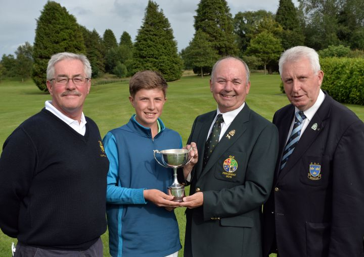 Michael Connaughton (President, Golfing Union of Ireland) presenting Alex Maguire (Laytown & Bettystown) with the 2015 Irish Boys Under 14 Amateur Open Championship trophy after his victory at Roscrea Golf Club today. (30/07/2015). Also in the picture are Noel McMahon (Captain, Roscrea Golf Club) and John Moloughney (Chairman, Munster Branch, GUI).Picture by Pat Cashman