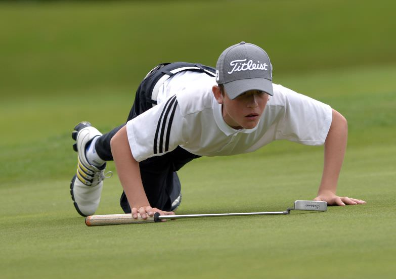 Dylan Keating (Seapoint) lining up his putt at the 15th hole during the 2015 Leinster Boys' Under 13 series Final (sponsored by Titleist) at the Castle Golf Club (06/08/2015). Picture by Pat Cashman