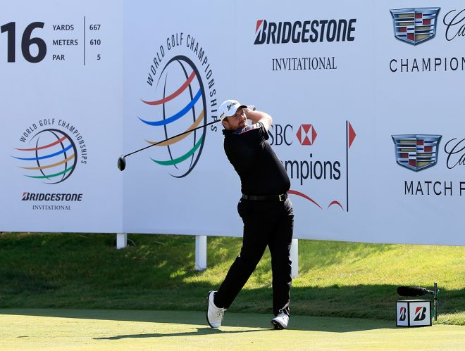 Shane Lowry drives on the par-five 16th at Firestone's South Course on Friday. Picture: Getty Images