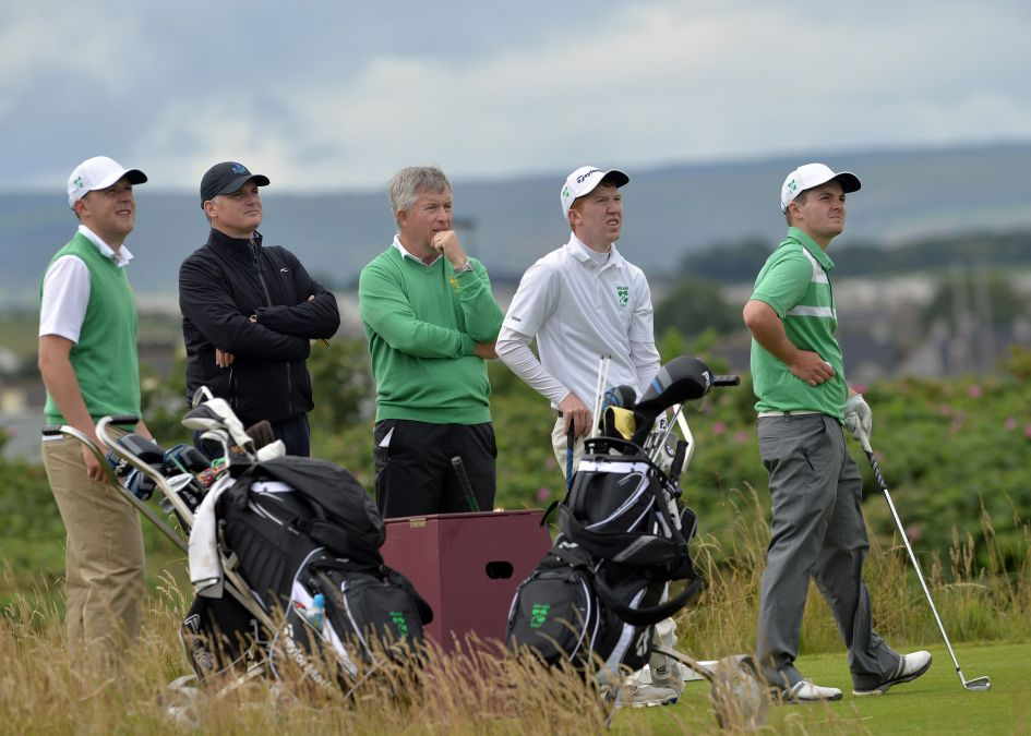Gary McNeill (Royal Portrush Professional) and John White (Team Manager) watching Paul McBride, Gavin Moynihan and Jack Hume practice to the 12th hole for the 2015 Home International Matches at Royal Portrush Golf Club (11/08/2015). Picture by Pat Cashman