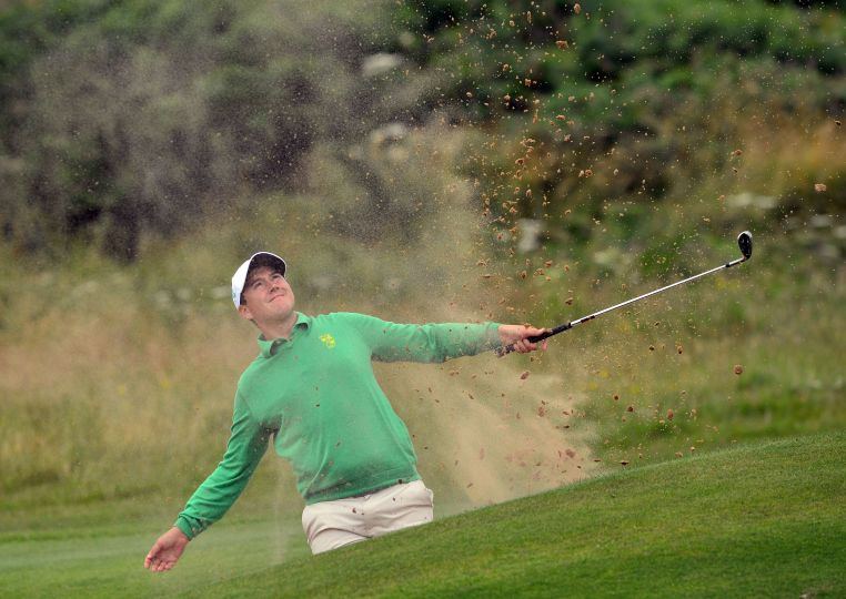 Colm Campbell (Ireland) bunkered at the 11th green on the first day of the 2015 Home International Matches at Royal Portrush Golf Club. (12/08/2015). Picture by  Pat Cashman